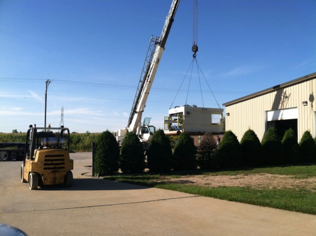 rigging corrugated machinery with crane
