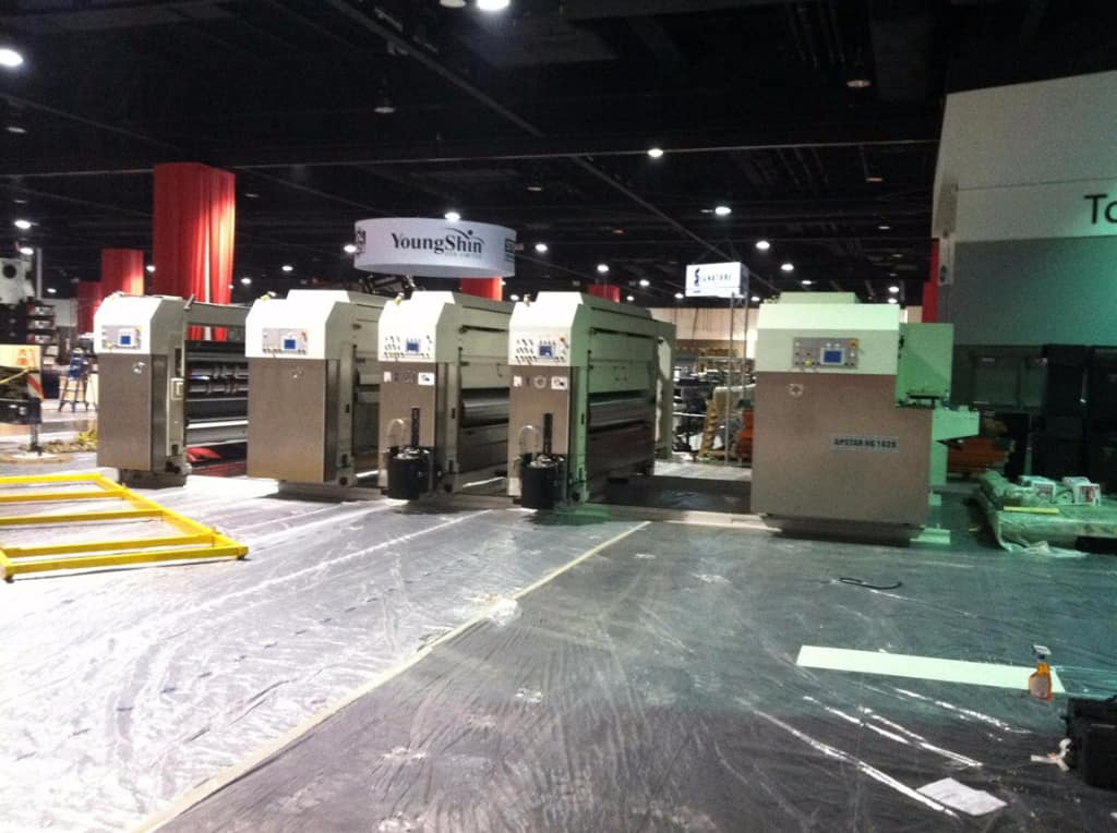 assembling corrugated machinery at Super Corr Expo